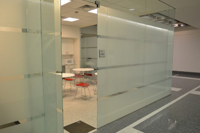 Finished Space with Glass Walls and Terrazzo Floors - Leads to Staff Break Area